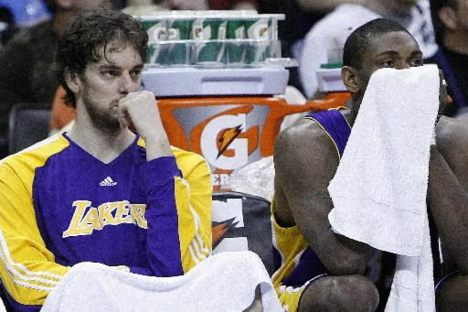 Photo - Pau Gasol, left, and Ron Artest watch the action in the fourth quarter of the  Thunder -  Lakers game March 26, 2010 in the Ford Center in Oklahoma City. BY HUGH SCOTT