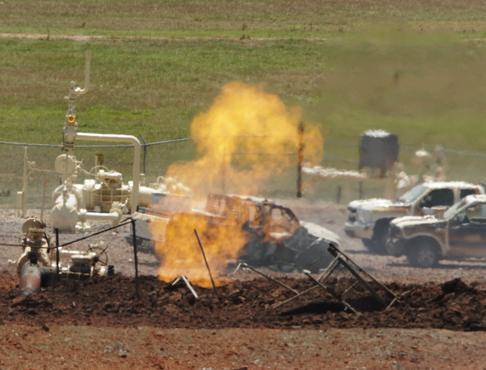 Photo - A small fire still burns at 12:00 pm. at the site of an explosion and fire at a natural gas pipeline in Grady County on Tuesday, June 29, 2010, west of Pocasset, Okla.   Photo by Steve Sisney, The Oklahoman