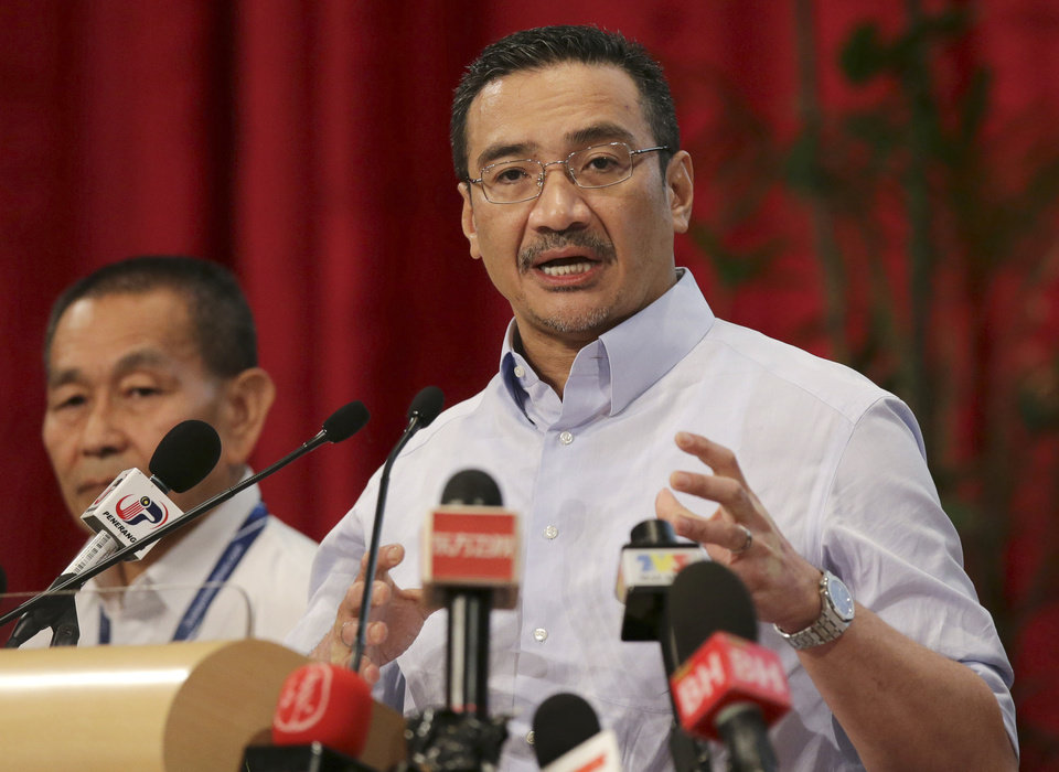 Photo - Malaysia's acting Transport Minister Hishammuddin Hussein, right, answers a reporter's question as Malaysia Airlines Group Chief Executive Ahmad Jauhari Yahya. left, listens during a press conference for the missing Malaysia Airlines flight MH370, at Putra World Trade Center (PWTC) in Kuala Lumpur, Malaysia, Friday March 28, 2014. The search area for the lost Malaysian jetliner moved 1,100 kilometers (680 miles) to the northeast on Friday, as Australian officials said a new analysis of radar data suggests the plane had flown faster and therefore ran out of fuel more quickly than previously estimated. (AP Photo/Aaron Favila)