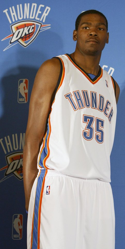 Photo - Kevin Durant models the home uniform for the Thunder at the uniform unveiling during media day for the Oklahoma City Thunder NBA basketball team at the Skirvin Hilton hotel in Oklahoma City, Monday, September 29, 2008. BY NATE BILLINGS, THE OKLAHOMAN. ORG XMIT: KOD