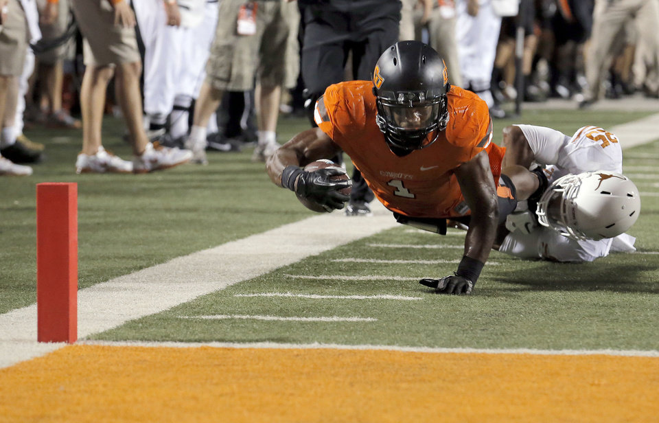 Photo - Oklahoma State's Joseph Randle (1) tries to make it to the end zone as Texas Josh Turner (25) makes a tackle during a college football game between Oklahoma State University (OSU) and the University of Texas (UT) at Boone Pickens Stadium in Stillwater, Okla., Saturday, Sept. 29, 2012. Texas on 41-36. Photo by Sarah Phipps, The Oklahoman