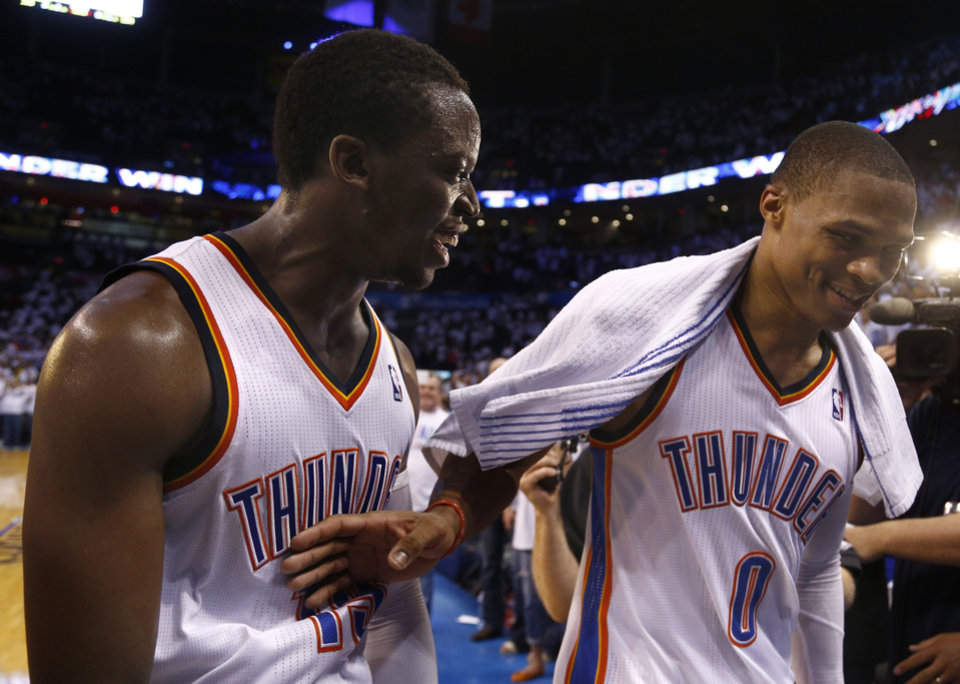 Photo - Oklahoma City's Reggie Jackson (15) and Russell Westbrook (0) celebrates as they leave the court following Game 5 of the Western Conference semifinals in the NBA playoffs between the Oklahoma City Thunder and the Los Angeles Clippers at Chesapeake Energy Arena in Oklahoma City, Tuesday, May 13, 2014. Photo by Sarah Phipps, The Oklahoman