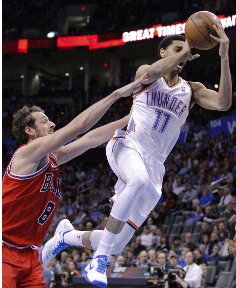 Chicago Bulls Marco Belinelli (8) gets a flagrant foul called on him against Oklahoma City Thunder guard Jeremy Lamb (11) during the third quarter of a NBA basketball game in Oklahoma City, Sunday, Feb. 24, 2013.  Oklahoma City won 102-72.  (AP Photo/Alonzo Adams)