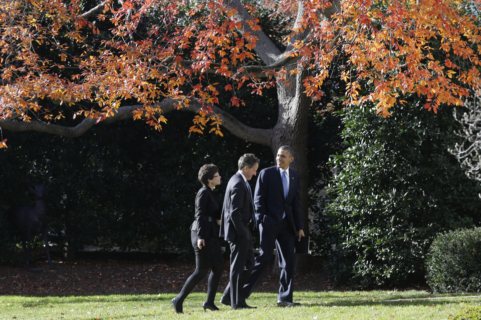 President Barack Obama walks with Treasury Secretary Timothy Geithner and White House senior adviser Valerie Jarrett on the South Lawn of the White House in Washington, Wednesday, Dec. 5, 2012,  as they returned from the Business Roundtable, an association of chief executive officers, where the president spoke about the fiscal cliff. (AP Photo/Charles Dharapak)