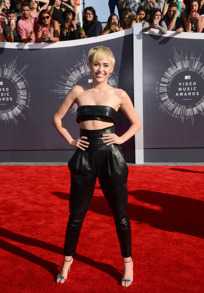 Photo - Miley Cyrus arrives at the MTV Video Music Awards at The Forum on Sunday, Aug. 24, 2014, in Inglewood, Calif. (Photo by Jordan Strauss/Invision/AP)