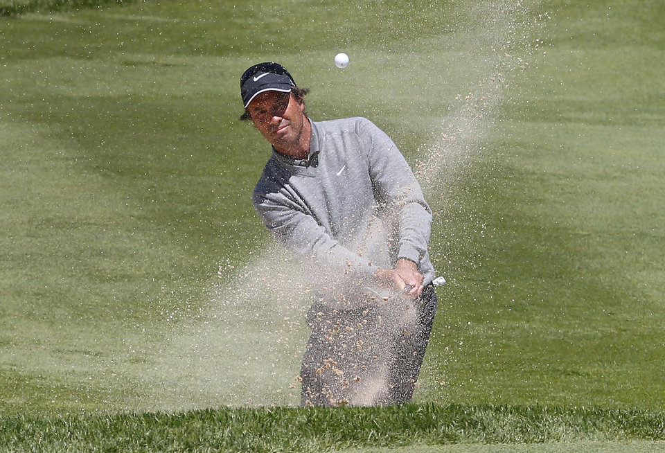 Photo - Stephen Ames hits out of a bunker on the 16th fairway during the second round of the 75th Senior PGA Championship golf tournament at Harbor Shores Golf Club in Benton Harbor, Mich., Friday, May 23, 2014. (AP Photo/Paul Sancya)