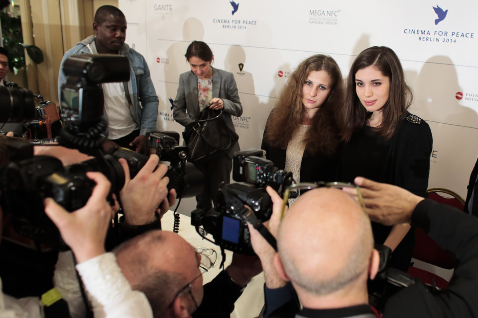 Photo - Nadezhda  Tolokonnikova,  righ, and Maria   Alekhina of Pussy Riot, participate in a press conference of the Cinema For Peace foundation in Berlin, Monday, Feb. 10, 2014.  (AP Photo/Markus Schreiber)