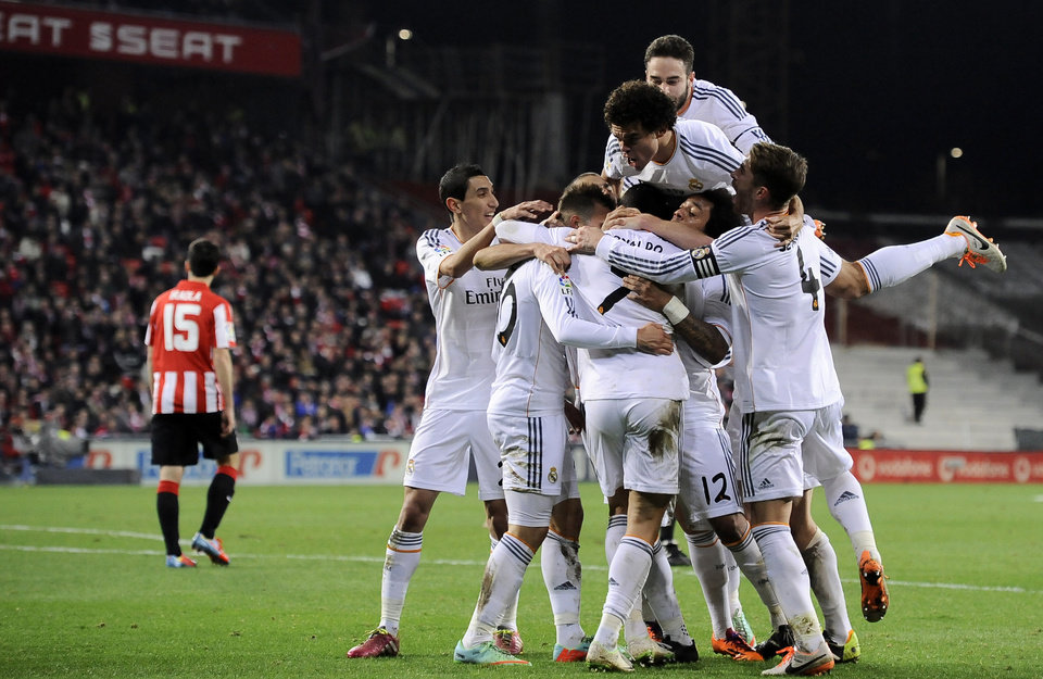 Photo - Real Madrid's players celebrates after Jese Rodriguez, surrounded by them, after scoring his goal during their Spanish League soccer match between Athletic Bilbao and Real Madrid, at San Mames stadium in Bilbao, Spain, Sunday, Feb. 2, 2014. (AP Photo/Alvaro Barrientos)