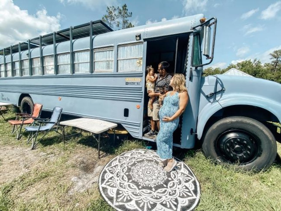 Photo -  The Hernandezes, Ian, Hannah and daughter Nora, climb aboard their 'skoolie,' a tiny home made from an old schoolbus. [PROVIDED/HANNAH HERNANDEZ]