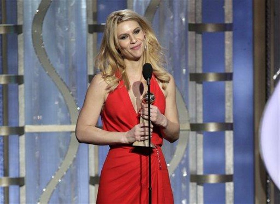 This image released by NBC shows Claire Danes with her award for best actress in a TV drama series for her role in