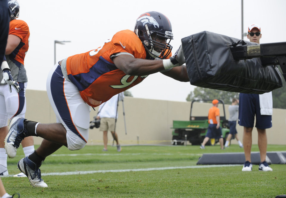Denver Broncos defensive end Jeremy Beal hits the sled during NFL football training camp, Monday, July 29, 2013, in Englewood, Colo. (AP Photo/Jack Dempsey) ORG XMIT: COJD106