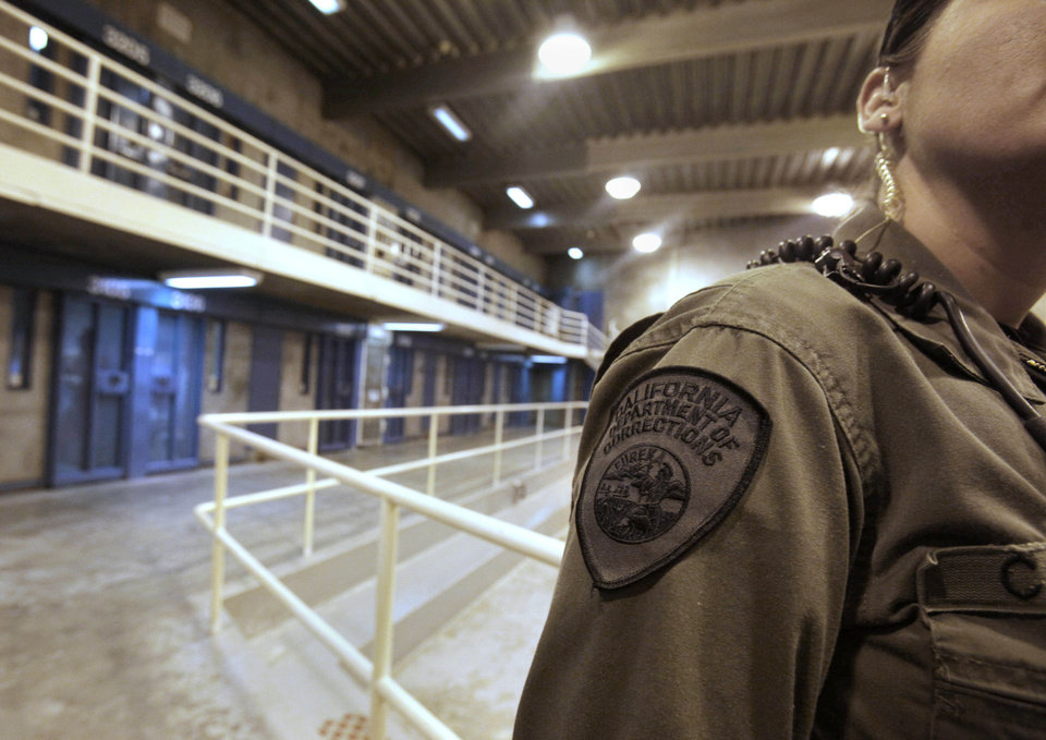 FILE -- In this Aug. 17, 2011 file photo,  a correctional officer is seen in one of the housing units at Pelican Bay State Prison near Crescent City, Calif. More than 30,000 of the 133,000 inmates in California prisons refused at least one meal, Monday July 8, 2013, in support of inmates held in solitary confinement at Pelican Bay State Prison. (AP Photo/Rich Pedroncelli, file)