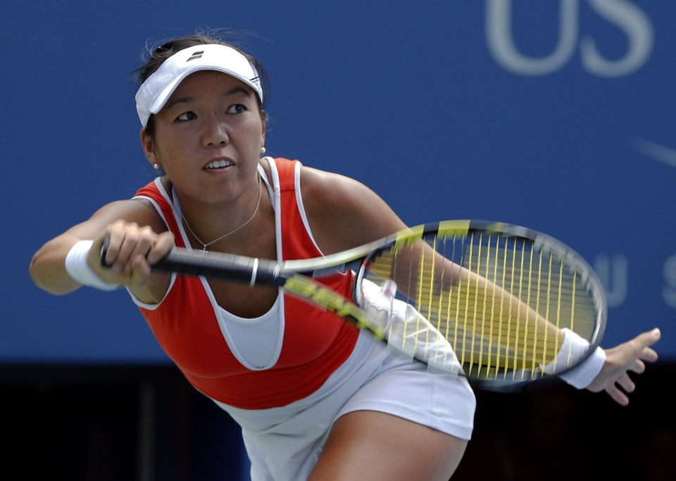 Photo - Vania King, of the United States, returns a shot to Serena Williams, of the United States, during the second round of the 2014 U.S. Open tennis tournament, Thursday, Aug. 28, 2014, in New York. (AP Photo/Elise Amendola)