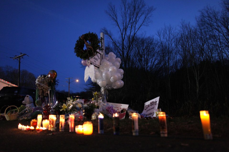 Photo - A memorial for shooting victims is seen near Sandy Hook Elementary School, Saturday, Dec. 15, 2012 in Newtown, Conn.  A gunman walked into Sandy Hook Elementary School in Newtown Friday and opened fire, killing 26 people, including 20 children. (AP Photo/Jason DeCrow) ORG XMIT: CTJD119