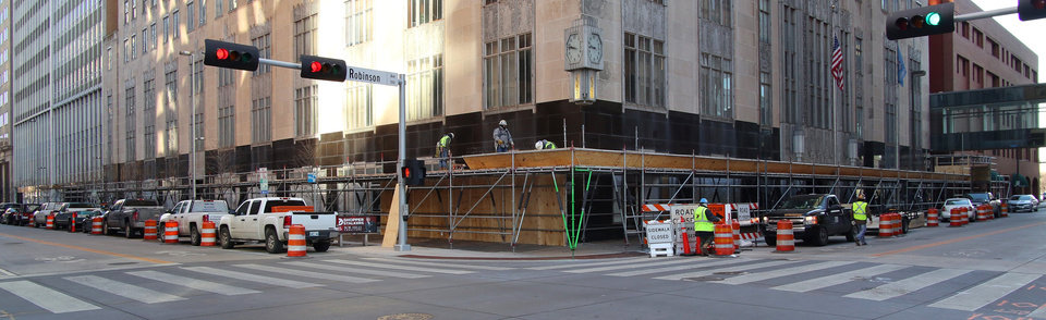 Photo -  Scaffolding wraps around the First National Center on Robinson Avenue and Park Avenue. Debris fell from the building Jan. 7, closing Robinson to pedestrians and traffic temporarily. The street now is open.