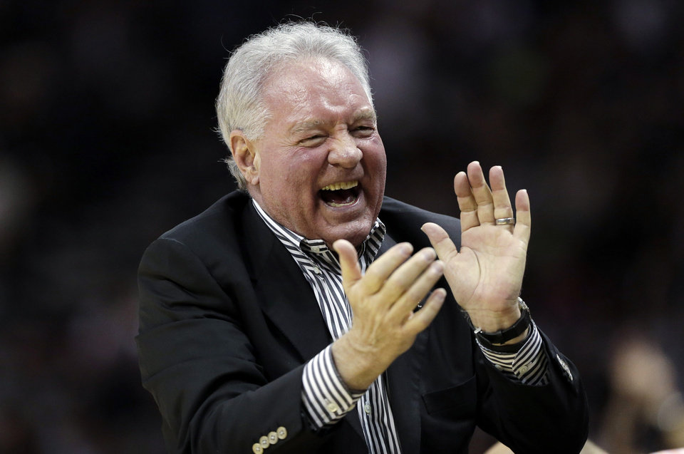 Photo - San Antonio Spurs owner Peter Holt cheers during the first half in Game 1 of a Western Conference Finals NBA basketball playoff series against the Memphis Grizzlies, Sunday, May 19, 2013, in San Antonio. (AP Photo/Eric Gay)