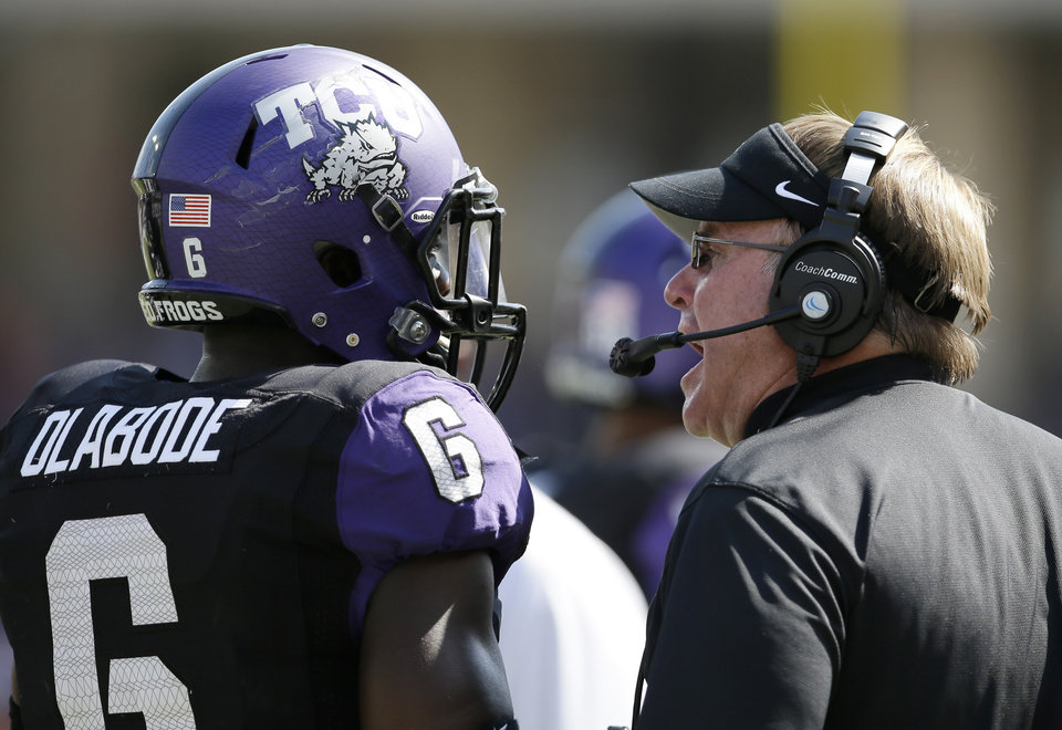 Photo - TCU head coach Gary Patterson, right, instructs safety Elisha Olabode (6) following a play against Kansas in the second half of an NCAA college football game, Saturday, Oct. 12, 2013, in Fort Worth, Texas. TCU won 27-176. (AP Photo/Tony Gutierrez) ORG XMIT: TXTG217