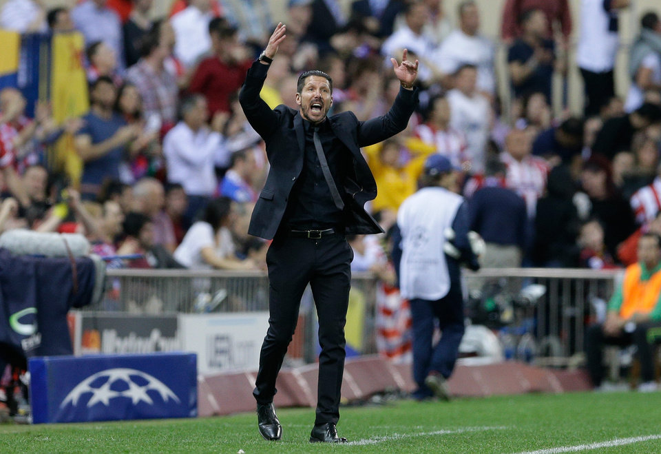 Photo - Atletico's coach Diego Simeone gestures during the Champions League quarterfinal second leg soccer match between Atletico Madrid and FC Barcelona in the Vicente Calderon stadium in Madrid, Spain, Wednesday, April 9, 2014. (AP Photo/Paul White)