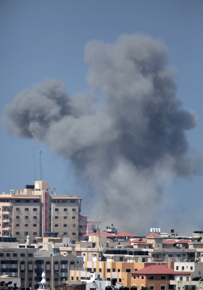 Photo - Smoke rises over Gaza City after an Israeli strike, Friday, Aug. 8, 2014, as Israel and Gaza militants resumed cross-border attacks after a three-day truce expired and Egyptian-brokered talks on a new border deal for blockaded Gaza hit a deadlock. (AP Photo/Khalil Hamra)
