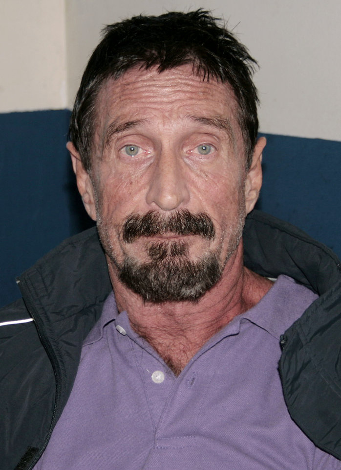 Photo - In this photo released by Guatemala's Human Rights Ombudsman's office, software company founder John McAfee is photographed in an immigration detention center in Guatemala City, Thursday, Dec. 6, 2012. The anti-virus guru was arrested at a hotel in an upscale neighborhood with the help of Interpol agents, hours after he said he would seek asylum in the Central American country. Guatemalan authorities were awaiting orders from their Foreign Ministry about whether to send him back to Belize, where he is a person of interest in the killing of a fellow expatriate American. (AP Photo/Guatemala's Human Rights Ombudsman's office)