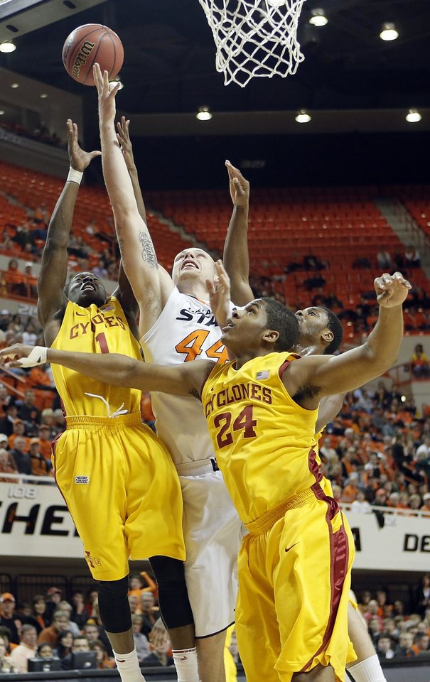Oklahoma State Cowboys\' Philip Jurick (44) battles for the ball with Iowa State Cyclones\' Bubu Palo (1) and Percy Gibson (24) during the college basketball game between the Oklahoma State University Cowboys (OSU) and the Iowa State University Cyclones (ISU) at Gallagher-Iba Arena on Wednesday, Jan. 30, 2013, in Stillwater, Okla. Photo by Chris Landsberger, The Oklahoman