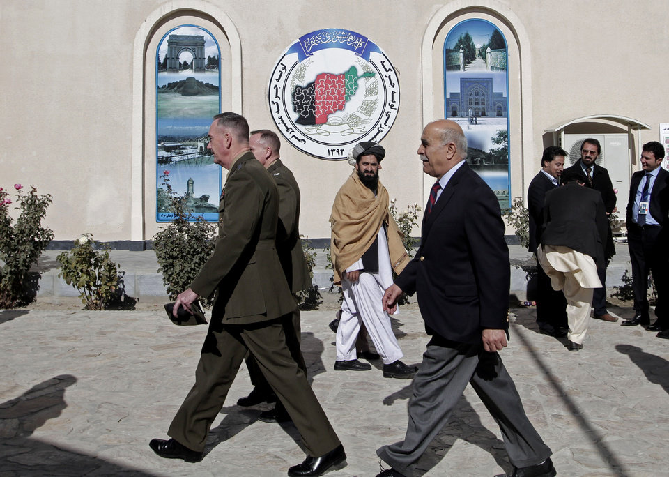 Photo - Commander of the International Security Assistance Force (ISAF) in Afghanistan, Joseph Dunford Lift, leaves the Afghan Loya Jirga meeting in Kabul, Afghanistan, Thursday, Nov. 21, 2013. Afghan President Hamid Karzai has told a gathering of elders that he supports signing a security deal with the United States if safety and security conditions are met. Karzai spoke as the 2,500-member national consultative council of Afghan elders known as the Loya Jirga started in Kabul on Thursday. The four-day meeting will discuss the bilateral security pact that defines the role of thousands of U.S. troops who will remain after the NATO combat mission ends in 2014. (AP Photo/Rahmat Gul)