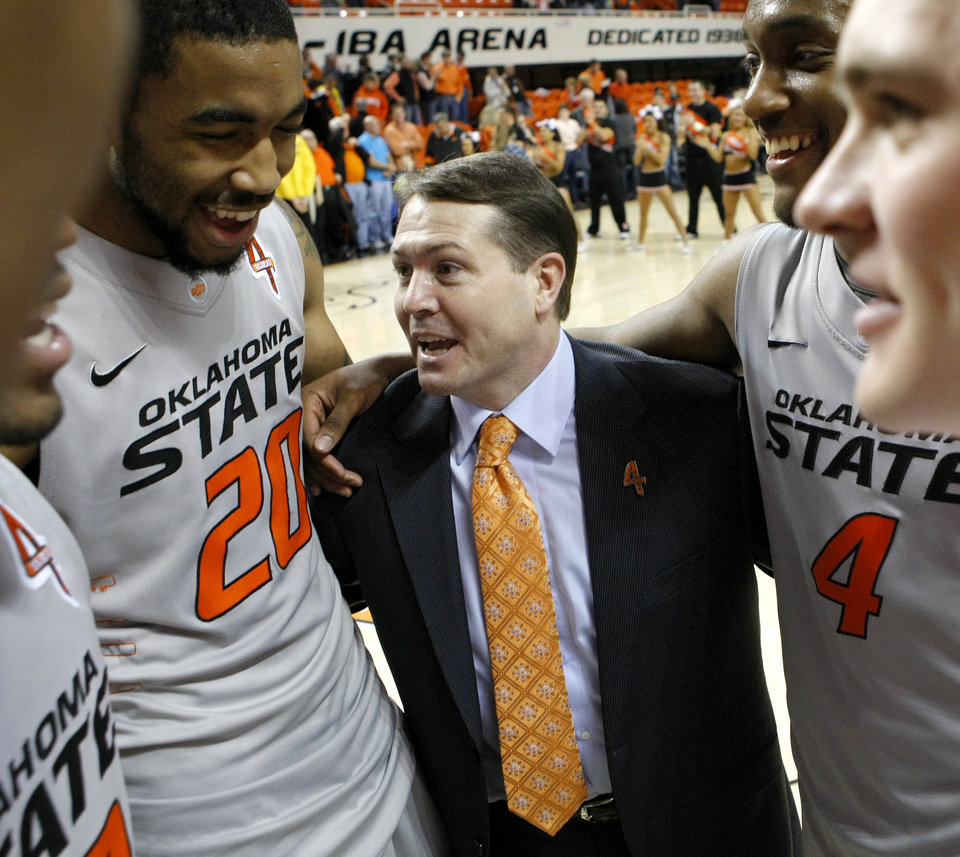 Oklahoma State coach Travis Ford talks with Michael Cobbins (20) and Brian Williams (4) after an NCAA college basketball game between Oklahoma State University (OSU) and the University of Texas (UT) at Gallagher-Iba Arena in Stillwater, Okla., Saturday, Feb. 18, 2012. Oklahoma State won 90-78. Photo by Bryan Terry, The Oklahoman