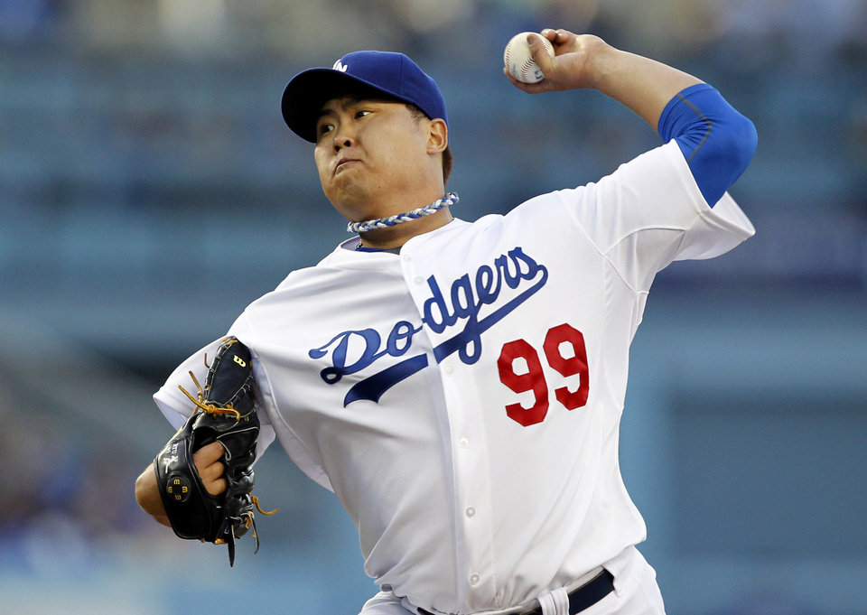 Photo - Los Angeles Dodgers starting pitcher Hyun-Jin Ryu throws against the Colorado Rockies in the first inning of a baseball game on Monday, June 16, 2014, in Los Angeles.   (AP Photo/Alex Gallardo)