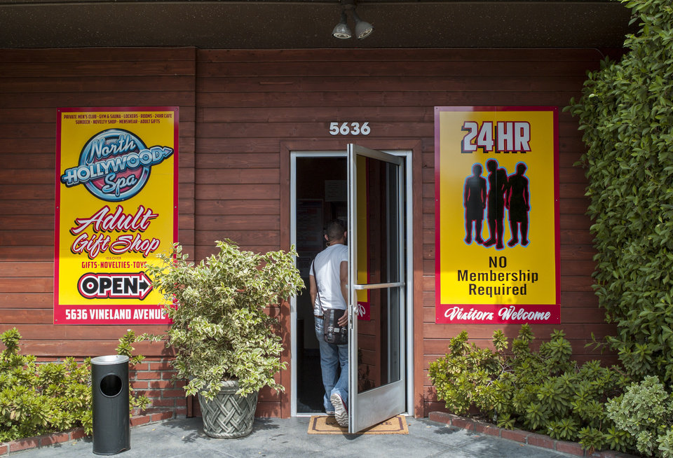 Photo - This July 30, 2014 photo shows the entrance to the North Hollywood Spa in Los Angeles. Gay bathhouses that once were shut down by laws or public outcry are facing a new pressure: lack of interest. A generation ago, bathhouses thrived at society's fringes, offering a discreet haven for friends and lovers to meet. To draw in customers, owners are rebranding clubs as open and upscale: renovating facilities, marketing on social media, and adding Wi-Fi, house DJs and meet-and-greets with adult film stars. (AP Photo/Damian Dovarganes)