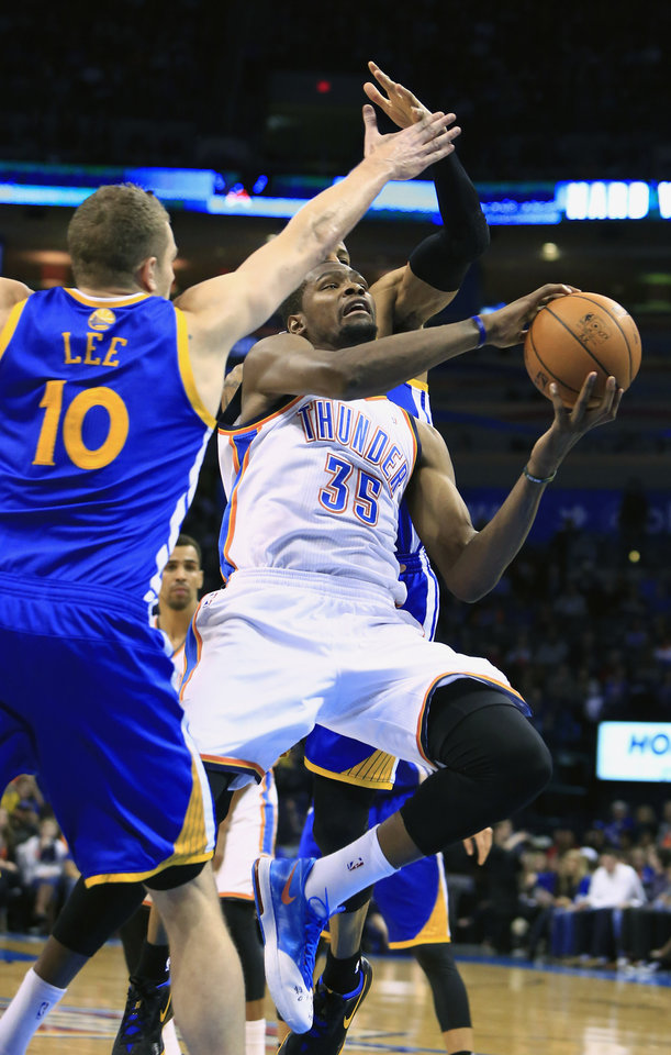 Photo - Oklahoma City Thunder small forward Kevin Durant (35) shoots as Golden State Warriors power forward David Lee (10) defends during the fourth quarter of an NBA basketball game Friday, Jan. 17, 2014, in Oklahoma City. Oklahoma City won 127-121. (AP Photo/Alonzo Adams)