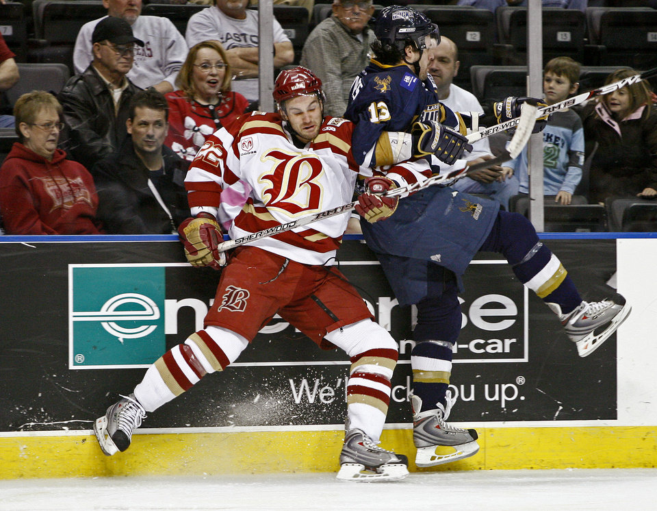 Photo - Mike Burgoyne of the Oklahoma City Blazers hits Steve Simoes of the Laredo Bucks during the first period of the CHL hockey game at the Ford Center in Oklahoma City, Friday, Jan. 18, 2008. BY BRYAN TERRY, THE OKLAHOMAN ORG XMIT: KOD