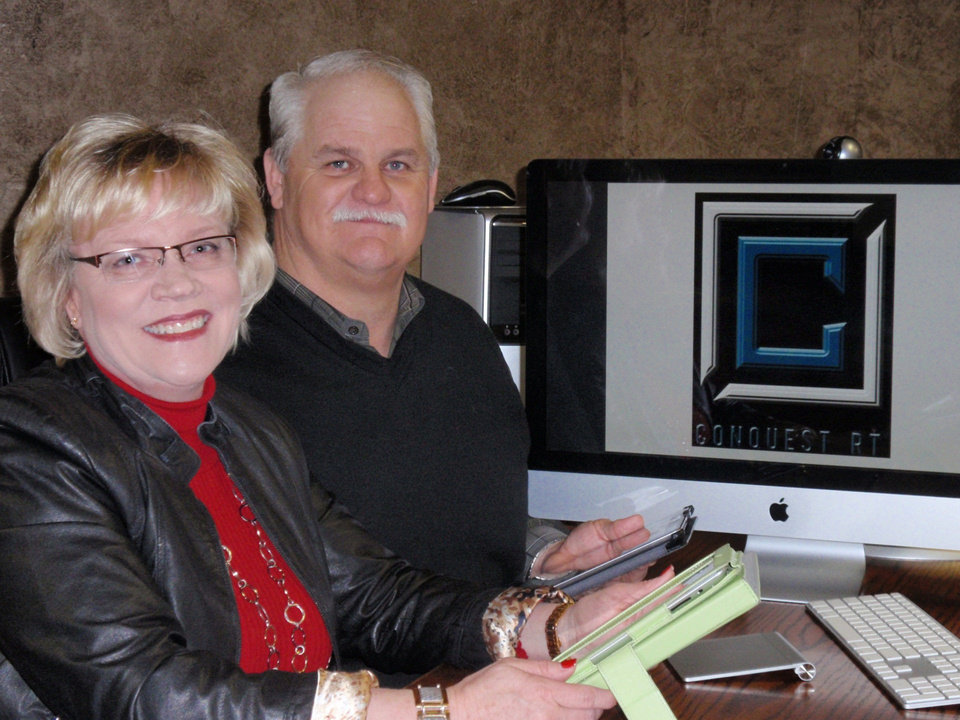 Photo - Debbie and Jim Hilton, who live in Beaver County in northwest Oklahoma near Knowles, have their iPads ready to work with new app they created, Conquest RT, which provides electronic ticketing for oil purchases. PHOTO PROVIDED.