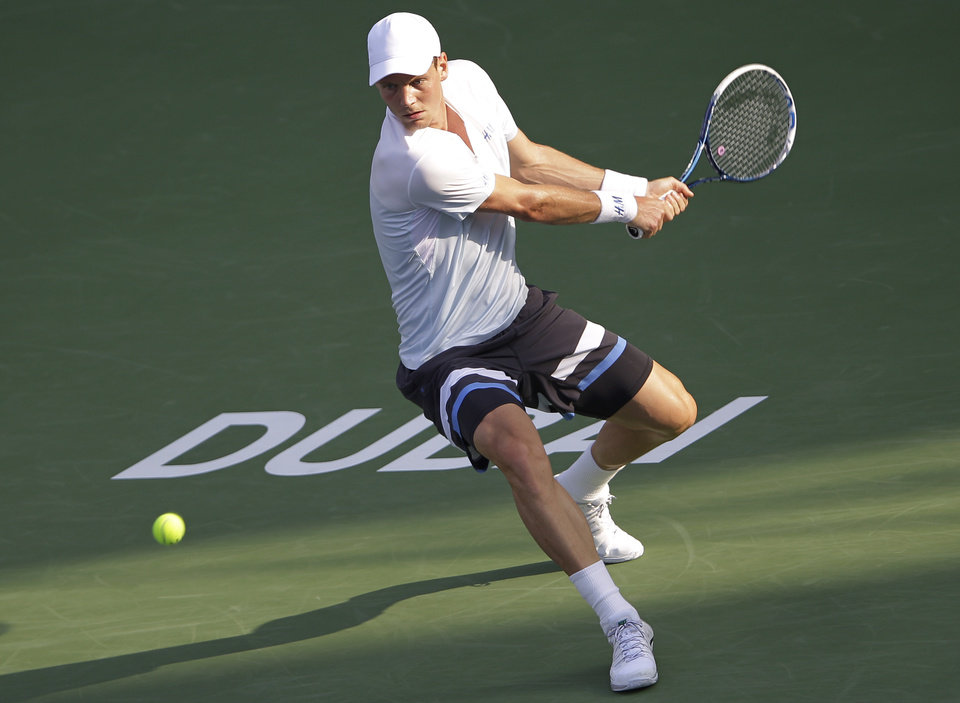 Photo - Tomas Berdych of Czech returns the ball to Sergiy Stakhovsky of Ukraine during the third day of the Dubai Duty Free Tennis Championships in Dubai, United Arab Emirates, Wednesday, Feb. 26, 2014. (AP Photo/Kamran Jebreili)
