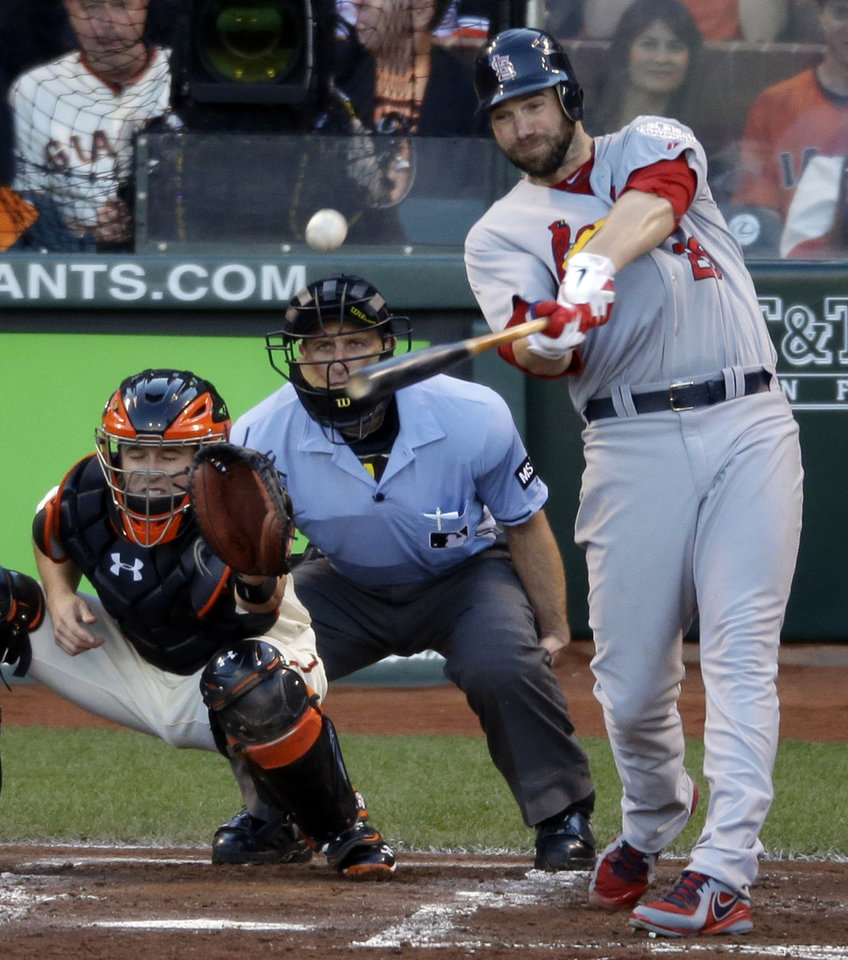 Photo -   St. Louis Cardinals' Chris Carpenter hits an RBI double during the second inning of Game 2 of baseball's National League championship series against the San Francisco Giants Monday, Oct. 15, 2012, in San Francisco. (AP Photo/Mark Humphrey)