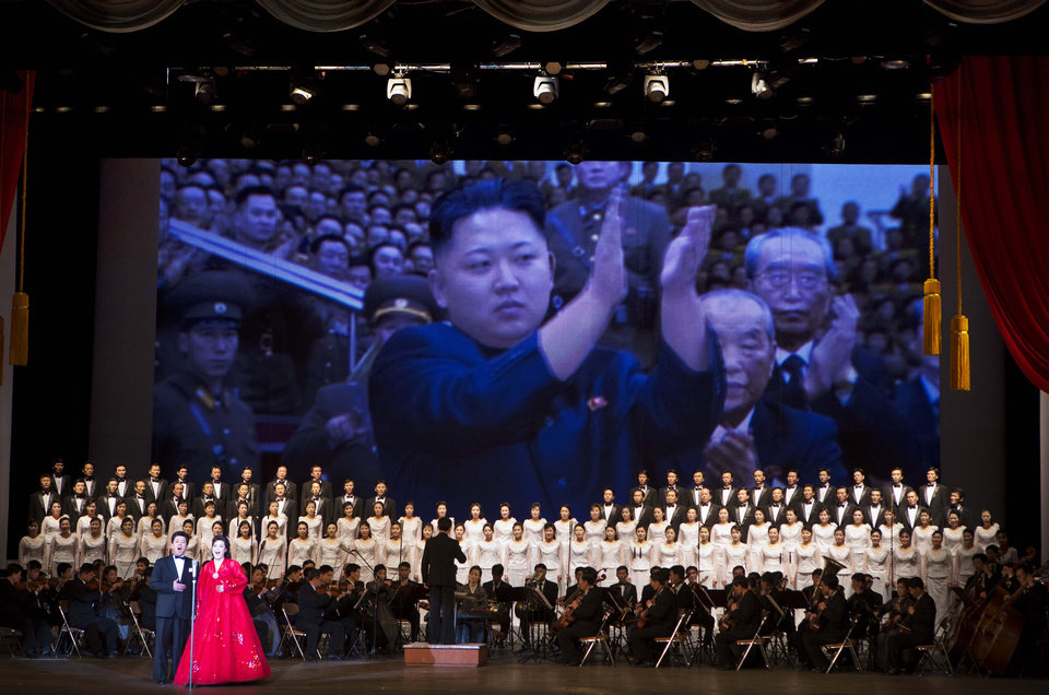 Photo - In this Feb. 17, 2013 photo, an image of North Korean leader Kim Jong Un is projected on a screen behind an orchestra and choir during a performance in Pyongyang, North Korea. (AP Photo/David Guttenfelder)