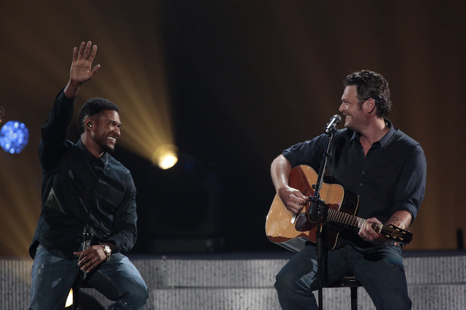 Photo - This image released by NBC Universal shows country singer Blake Shelton, right, and Usher perform the duet