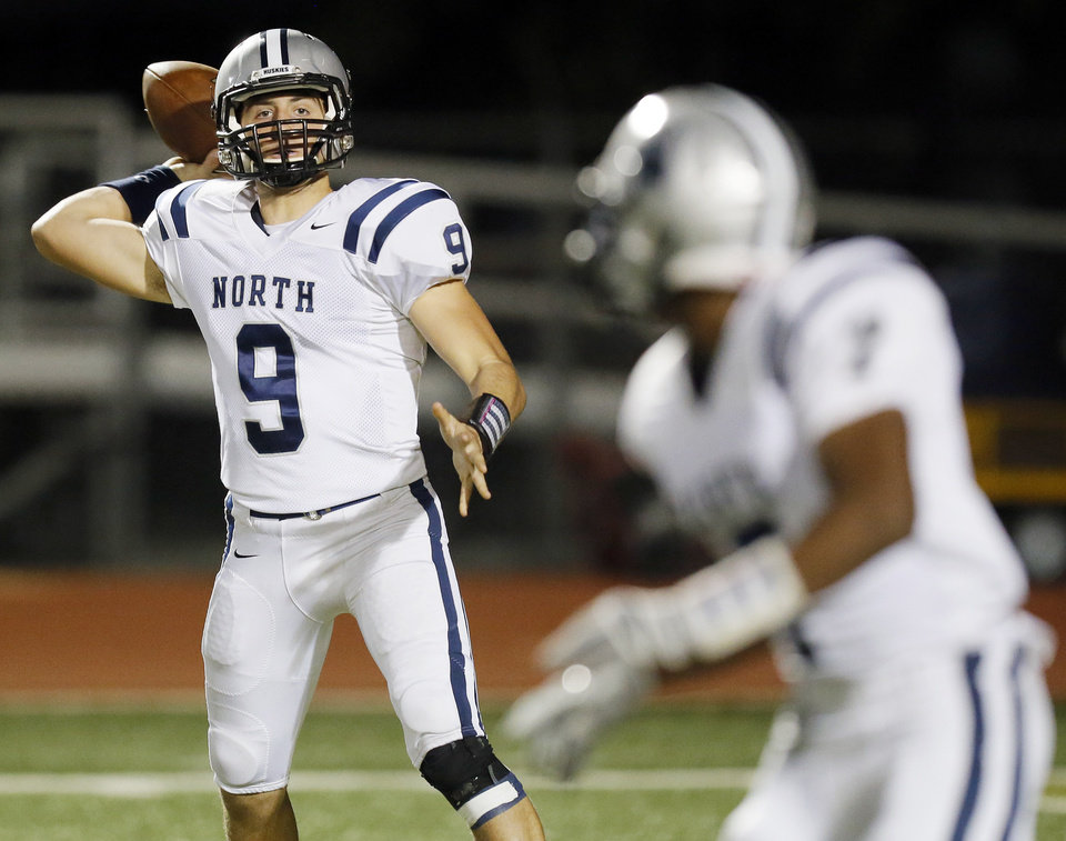 Photo - Edmond North's Luke Hoskins (9) passes to Marque Depp (7) during a high school football game between Edmond North and Norman North in Norman, Okla., Thursday, Oct. 11, 2012. Photo by Nate Billings, The Oklahoman