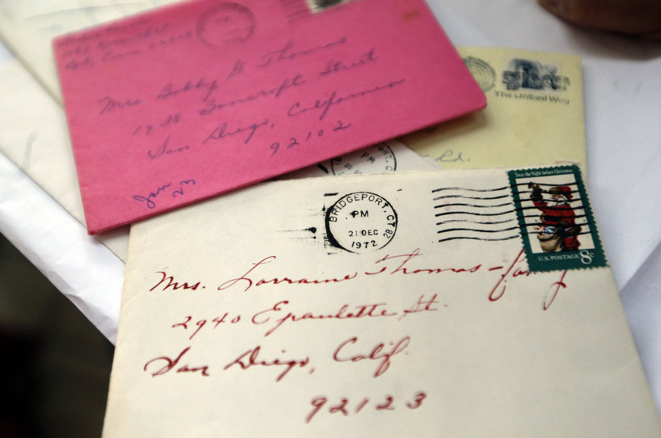 Photo - Letters Sadie Fanali sent to Lorraine Thomas are pictured. The pair met for the first time at Will Roger World Airport, Friday, June 14, 2013, in Oklahoma City.  They have been pen pals since 1932. Photo by Sarah Phipps, The Oklahoman