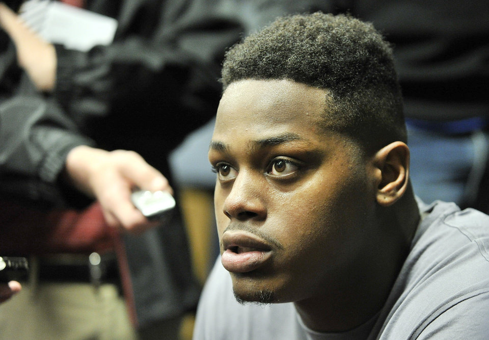 Photo - In this March 29, 2014 photo, Auburn offensive lineman Shon Coleman talks to the media after an NCAA college spring football practice at the Auburn Athletic Complex in Auburn, Ala. Coleman is battling to replace Greg Robinson as the starting left tackle a few years after overcoming a much tougher fight against cancer. (AP Photo/AL.com, Julie Bennett)