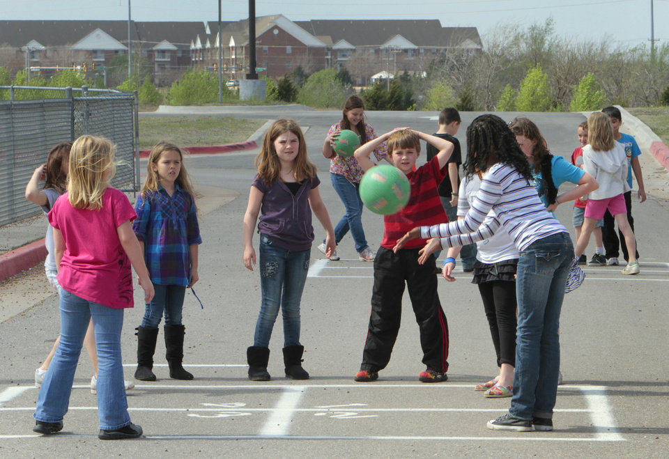 Students play outside at Haskell Elementary School in northwest Oklahoma City , Wednesday, March 14, 2012.  This year the school system has not used their snow days. Photo By David McDaniel/The Oklahomen