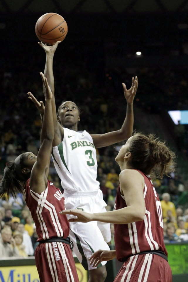 Baylor\'s Jordan Madden (3) shoots over Oklahoma\'s Aaryn Ellenburg, left, and Morgan Hook during the NCAA college basketball game Saturday, Jan. 26, 2013, in Waco Texas. Baylor won 82-65. (AP Photo/LM Otero) ORG XMIT: TXMO119