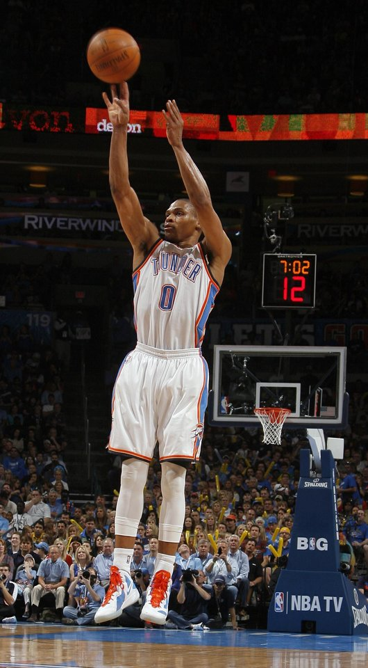 Oklahoma City's Russell Westbrook (0) shoots a three-pointer during the NBA basketball game between the Chicago Bulls and the Oklahoma City Thunder at Chesapeake Energy Arena in Oklahoma City, Sunday, April 1, 2012. Photo by Sarah Phipps, The Oklahoman