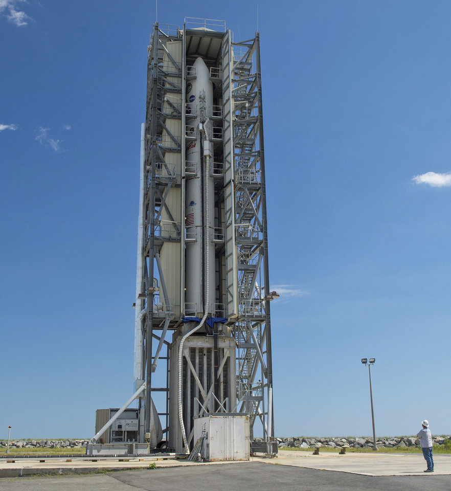 Photo - In this image provided by NASA, the doors of the gantry support structure are opened to reveal the Minotaur V rocket on Pad 0B at the Mid-Atlantic Regional Spaceport at NASA's Wallops Flight Facility, Friday, Sept. 6, 2013, in Wallops Island, Va. The unmanned rocket is scheduled to blast off late Friday night with a robotic explorer that will study the lunar atmosphere and dust. (AP Photo/NASA, Carla Cioffi)