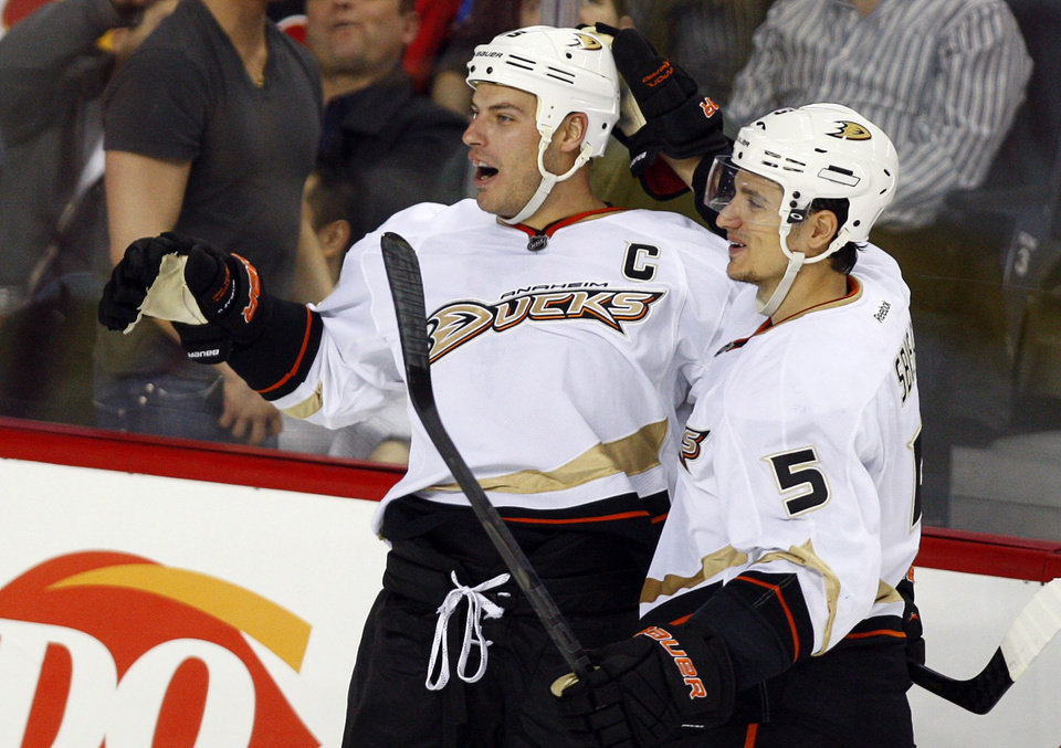 Anaheim Ducks\' Ryan Getzlaf, left, celebrates his winning goal with Luca Sbisa, of Italy, against the Calgary Flames during the third period of their NHL hockey game, Monday, Jan. 21, 2013, in Calgary, Alberta. The Ducks won 5-4. (AP Photo/The Canadian Press, Jeff McIntosh)