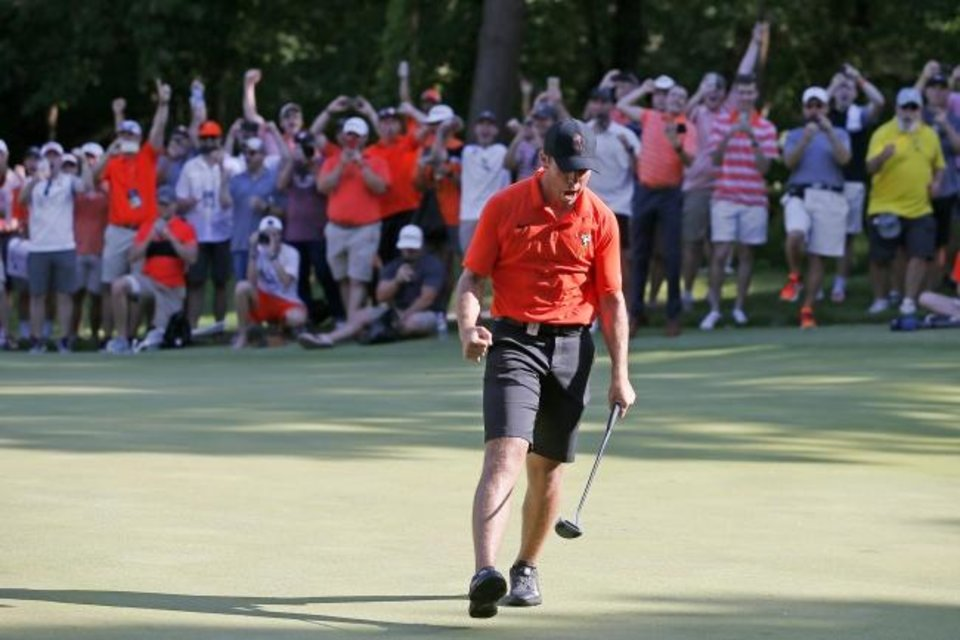 Photo -  Matthew Wolff sunk the putt to clinch the national title for Oklahoma State last season. It was just a precourser for this season as the Cowboy sophomore is not only winning at a historic clip but also capturing the imagination of the golf world. [BRYAN TERRY/THE OKLAHOMAN]