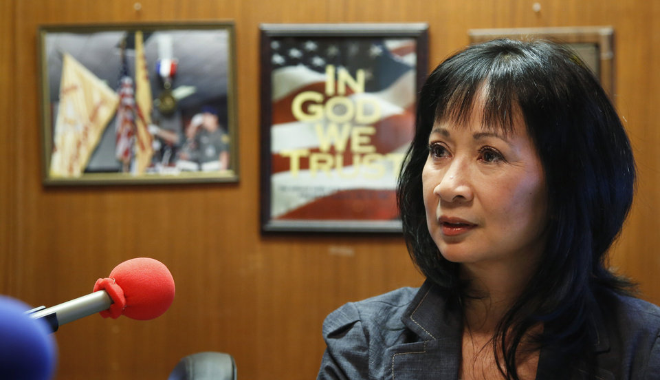 Photo -  Mai Ly Do has operated a Vietnamese radio station for 12 years. Mai helps keep the Vietnamese community connected, using their native language. During the May 20 storms, Mai stayed at her radio studio and kept broadcasting to ensure that Vietnamese Oklahomans knew when to take shelter. She provides an important service for a dedicated group of listeners.    Jim Beckel -  THE OKLAHOMAN