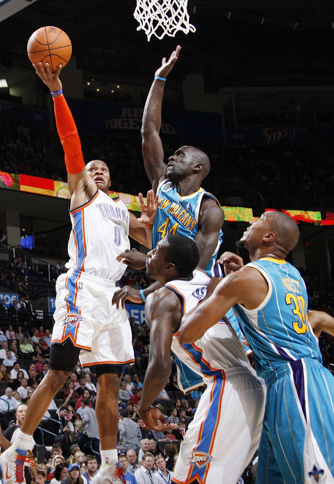 Photo - Oklahoma City's Russell Westbrook (0) shoots around the defense of Pops Mensah-Bonsu (44) of New Orleans in front of Jeff Green (22) of Oklahoma City and David West (30) of New Orleans during the preseason NBA basketball game between the New Orleans Hornets and the Oklahoma City Thunder at the Ford Center in Oklahoma City, Thursday, October 21, 2010. Photo by Nate Billings, The Oklahoman