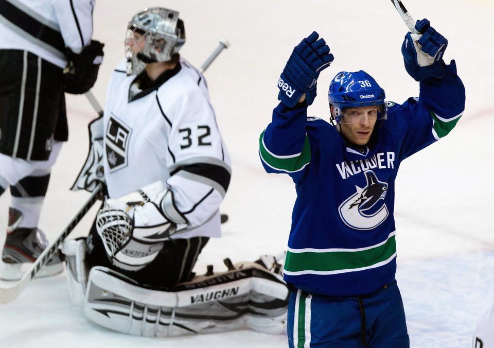 Vancouver Canucks' Jannik Hansen, right, of Denmark, celebrates after scoring against Los Angeles Kings goalie Jonathan Quick, left, during the second period of an NHL hockey game in Vancouver, British Columbia on Saturday, March 2, 2013. (AP Photo/The Canadian Press, Darryl Dyck)