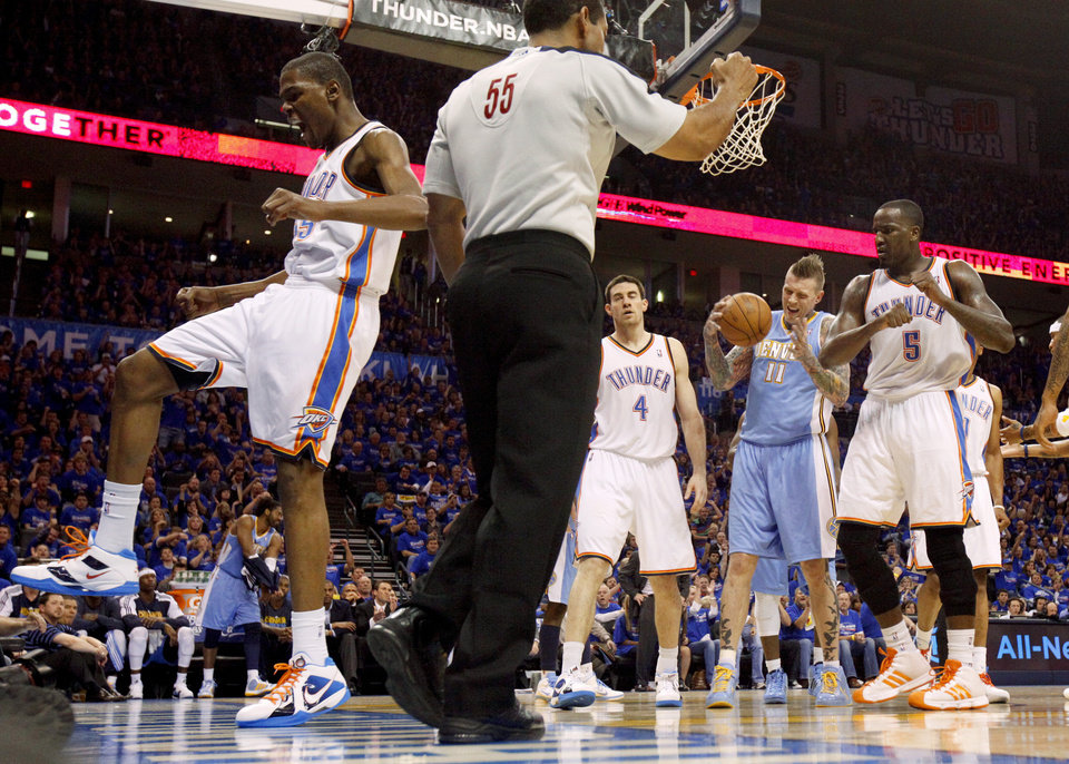 Oklahoma City\'s Kevin Durant (35) celebrates beside Nick Collison (4), Denver\'s Chris Andersen (11), and Oklahoma City\'s Kendrick Perkins (5) during the NBA basketball game between the Denver Nuggets and the Oklahoma City Thunder in the first round of the NBA playoffs at the Oklahoma City Arena, Sunday, April 17, 2011. Photo by Bryan Terry, The Oklahoman