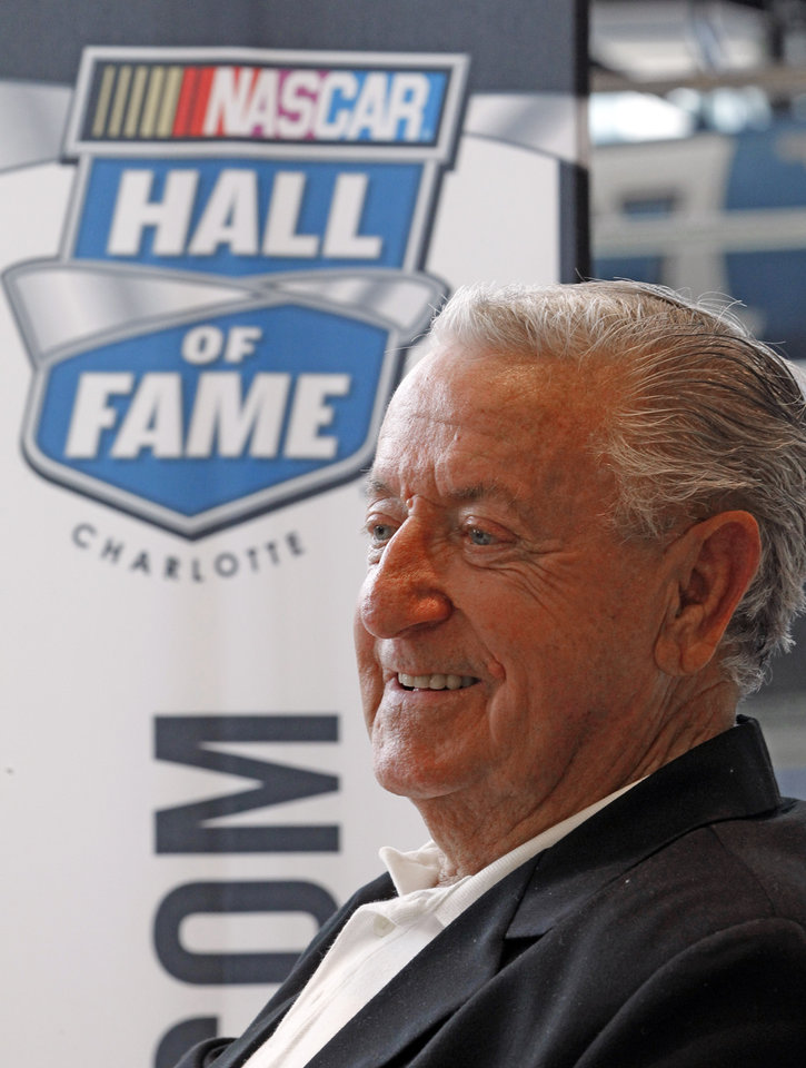 Photo - Rex White waits to be interviewed after being named as one of five inductees into the NASCAR Hall of Fame class of 2015, in Charlotte, N.C., Wednesday, May 21, 2014. (AP Photo/Terry Renna)